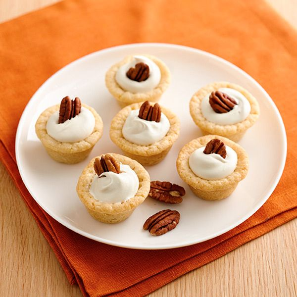 Pecan Cookie Cups with Maple Cream : These mini cookie cups are filled with light and flavorful maple cream and topped with crunchy pecans.