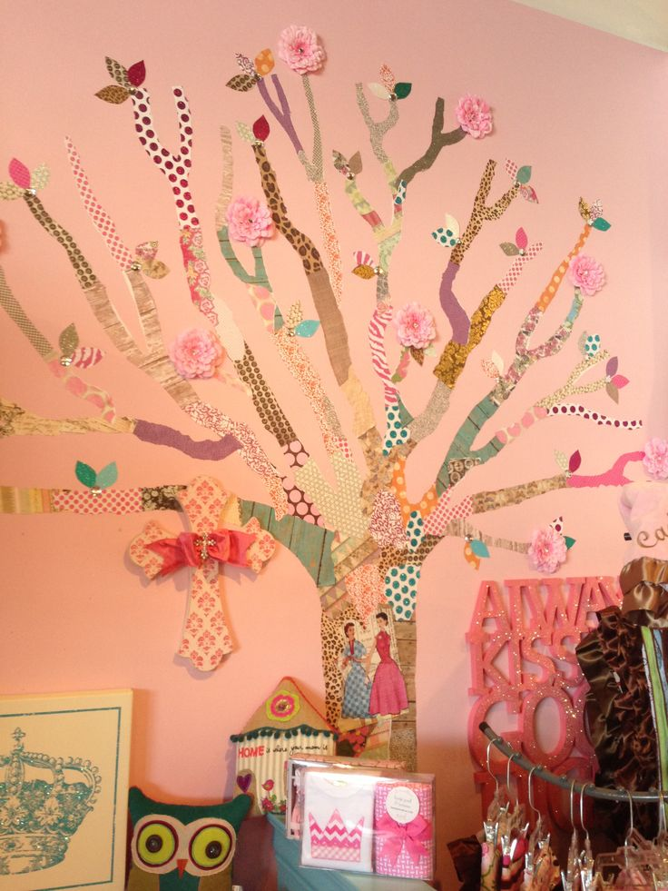 Scrapbook paper and fake flowers used to make a tree on