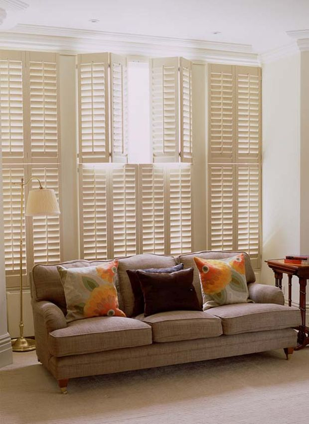 Tier on Tier solid wooden plantation shutters. The New England Shutter Company - New England shutter design.