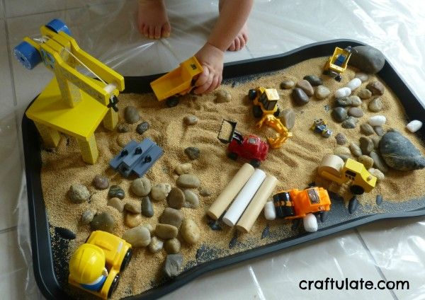 This construction site sensory play was easy to set up and uses toy trucks, stones, sand, and grains from the pantry.