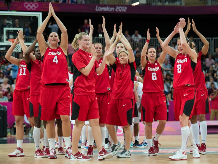 The Canadian women's basketball team celebrates a win against Great Britain during preliminary action at the 2012 London Olympic Games, on July 30, 2012. Canada beat Great Britain 73-65.  COC photo: Jason Ransom