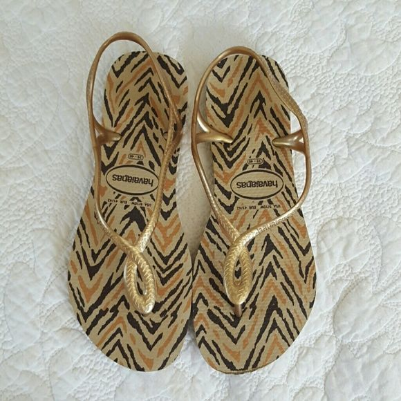 Havaianas Luna Gold Animal Print ??WORE ONCE?? Wear it day or night, the Luna Animals Flip Flops is the cat's meow!Rubber upper.Easy slip-on wear.Thong-style construction.Twisted slingback style.Lightly padded man-made footbed with fun animal print.Textured man-made sole.Made in Brazil. Havaianas Shoes Sandals