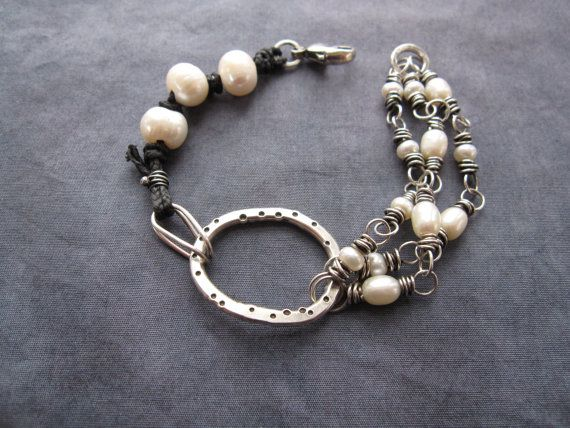Wire & pearls. Interesting mix, (esp. that folded over link) but be prepared to ream the pearls big time to get them onto a cord.