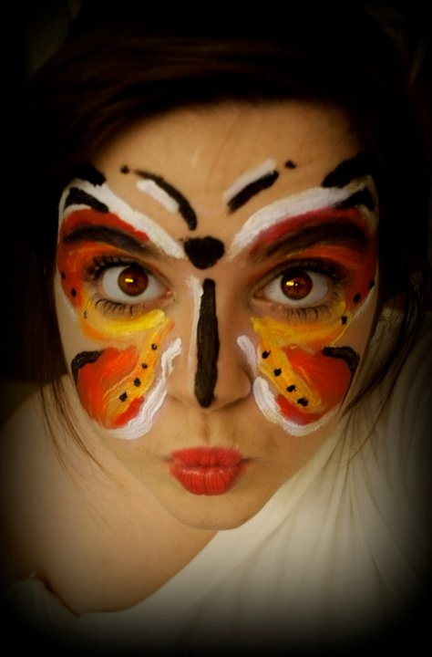 NOT sure what kind of paint is being used here, but you can bet it's not quality face paint. There's a big difference. The Face Painting School recommends only using cosmetic grade face paint on skin. Butterfly Face Painting Design