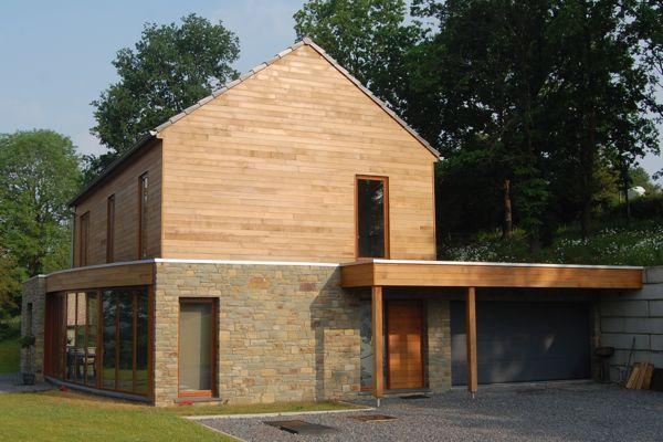 Maison bioclimatique sur terrain en pente architecture pinterest for Maison bioclimatique