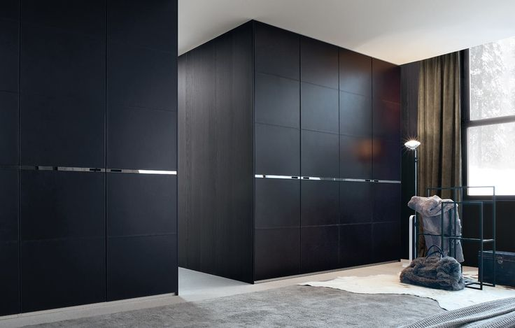 Poliform|Varenna_winter home_Senzafine Bangkok wardrobe, leaf doors covered in hide with visible topstitching.
