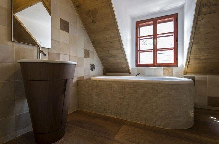 Obklad koupelen si zvolil majitel.