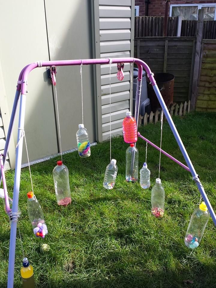 Lots of plastic bottles filled with different things then hung on an old swing via Sarah Blaylock ≈≈