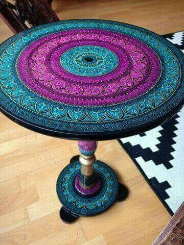 Love this- I have 2 end tables that we could paint (they're square, but with the right colors, I think it could work)
