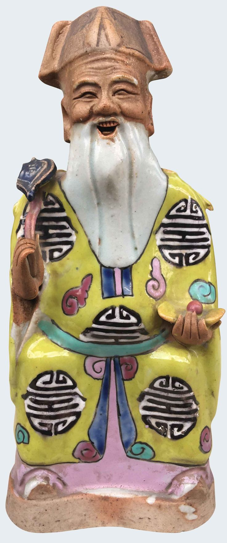 A large Chinese porcelain famille rose figure of the immortal Shou-Lao. Jiaqing period. Decorated in the famille rose enamels, his clothes with the character Shou.