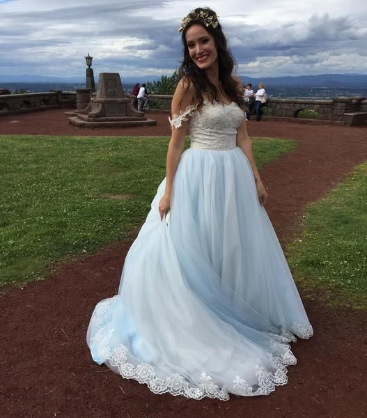 Beautiful ice blue wedding dress with lace bodice, featuring ball gown skirt with layers of tulles, and a light champagne bodice covered with tulle accented with ivory lace and light blue beadings. Wo