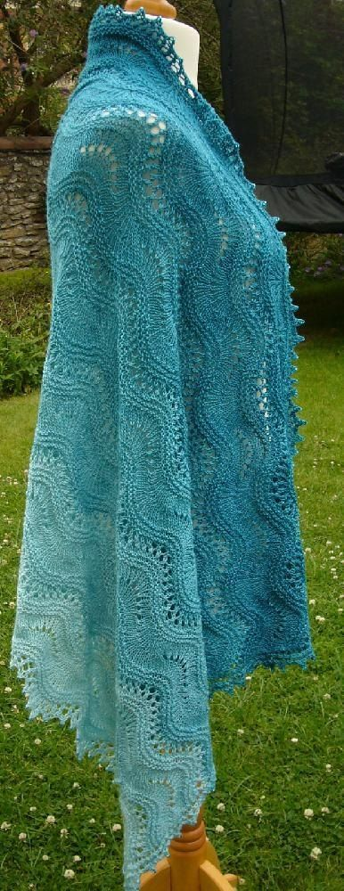 This pattern was inspired by sitting next to the Cornish sea watching little rippling waves of turquoise sea washing in and out over the golden sands. Bliss. I created it to have rippling textured garter stitch waves and sections of yarn overs to look like the little bubbles on the waves. The pattern includes instructions for a shawl with beaded picot edging, a baby blanket and a cowl The width and length of the any of the items is easily adjusted so that you can make a your shawl blanket or…