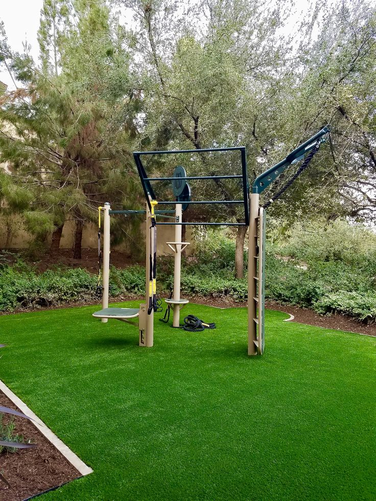 Outdoor gym for golf community fitness area. Utilizing the custom MovrStrong T-Rex outdoor fitness station