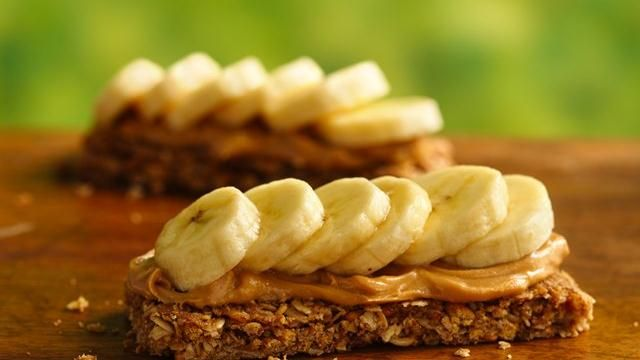 This smart snack couldn't be any easier.  Spread a granola bar with peanut butter and add banana slices -- how cool is that?
