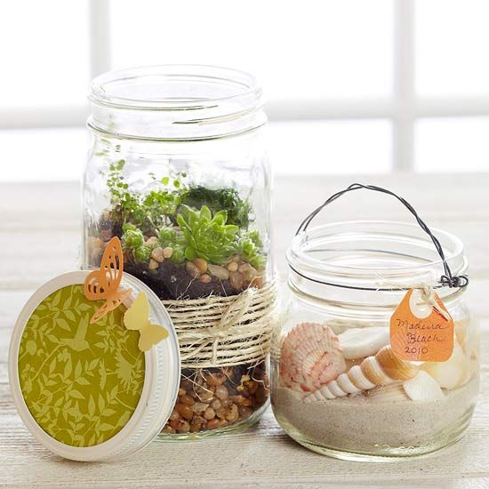 Nature Jar Display - Remember a trip to the beach or a favorite camping trip by gathering natural elements, such as sand, rocks, or shells. Place them in glass jars and wrap the jars with raffia or twine.