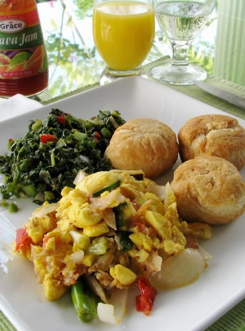 Ackee saltfish callaloo fried dumplings with a glass for Salt fish ackee