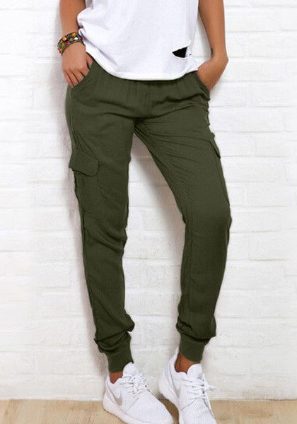 This rifle green cargo joggers features elastic mid waist in tapered style, together with a drawstring detailing, and pockets at both sides and back. Shop one now. | Lookbook Store