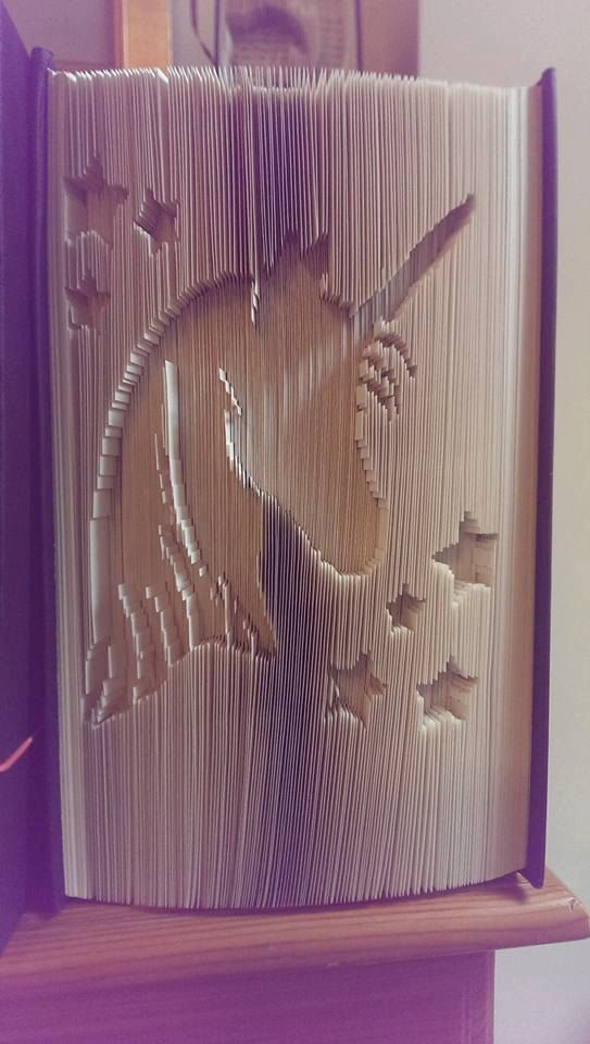 Book folding pattern of a unicorn. Checkout our crazy pattern packages