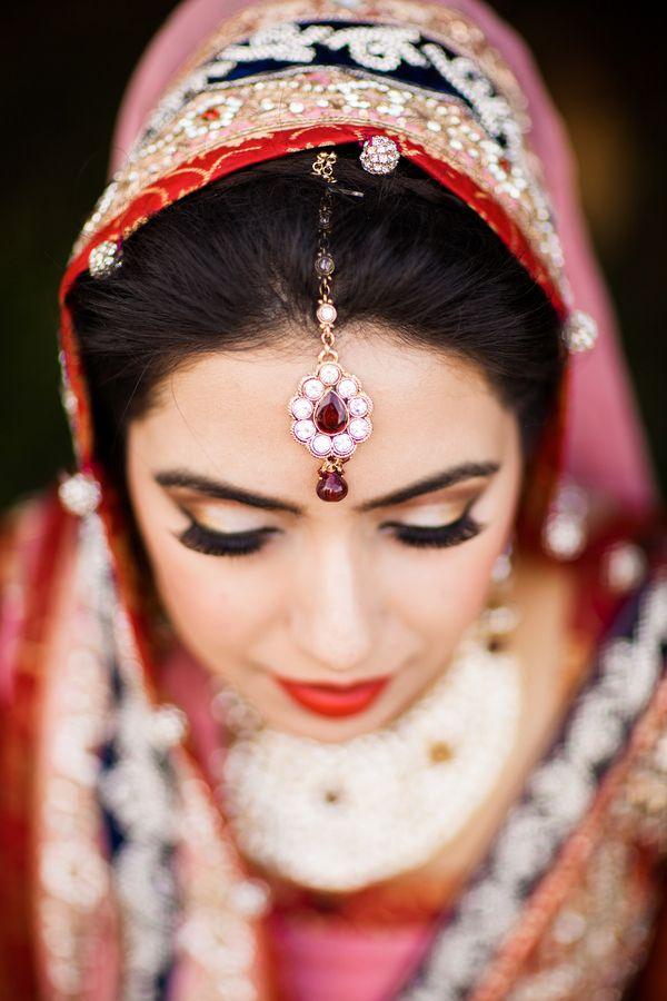 Bold lips and lush lashes—so beautiful! {Photo by Nyk + Cali Wedding Photographers via Project Wedding}