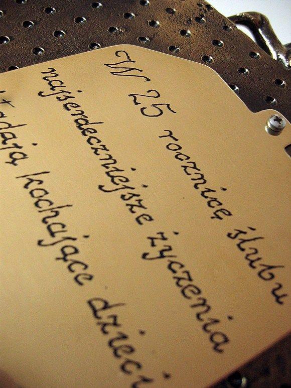 mosiężna tabliczka z grawerem