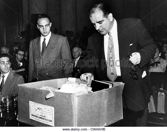 Senator Joseph McCarthy (right) and his attorney, Roy Cohn, examine files during the Army-McCarthy hearings, 1954. - Stock Image
