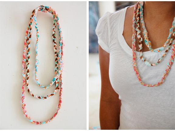 DIY fabric necklace. Take scraps of fabric, tear into strips, braid then sew the various lengths together in the back.