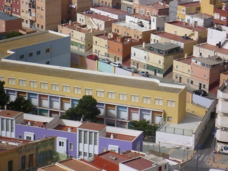 Almería Spain, yellow and purple buildings.  James Hackworthy 2011