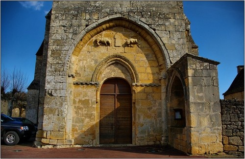 VITRAC [24] - Porch of the church (animals carved in high relief and enfeu right)