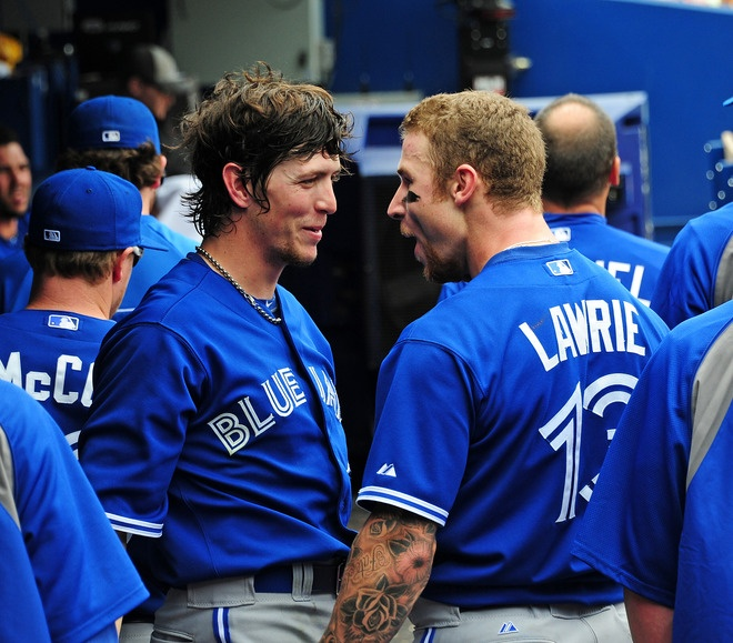 Colby Rasmus and Brett Lawrie share a moment
