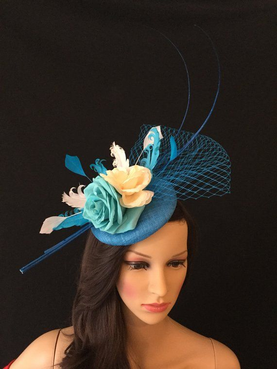 3c859c727f4b8 Feathers · Fascinators · this hat is perfect for special occasions.  featuring artificial flowers with light blue and ivory