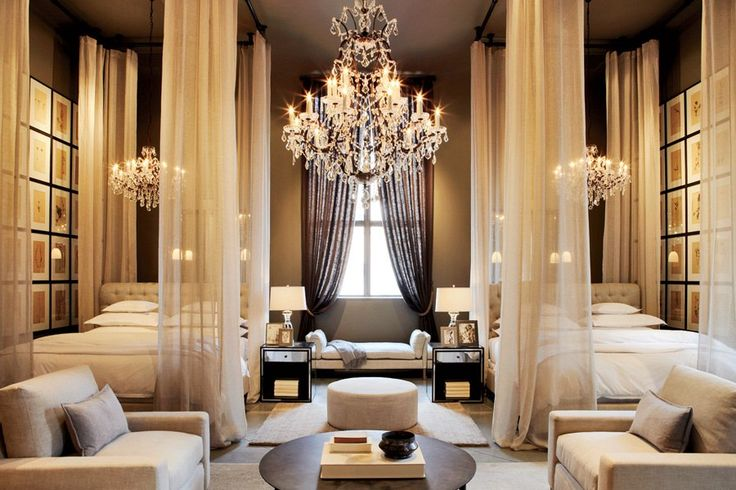 Restoration Hardware's Boston Flagship Store includes this elegant space that softly frames the beds using sheer curtains against a dark background for dramatic effect.