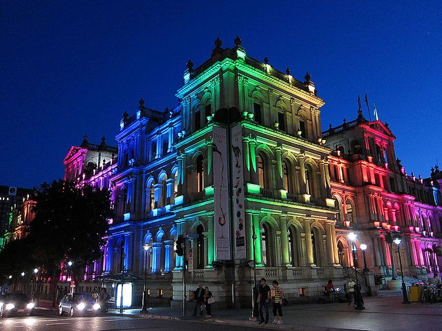 The Casino Treasury in Brisbane, Australia, lights up with rainbow colors to celebrate Brisbane Pride.