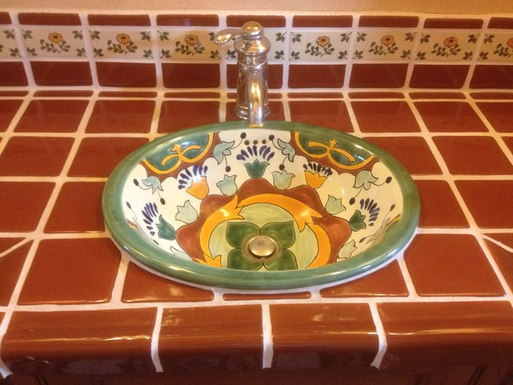 bathroom countertop in terra cotta brown mexican field tile and decora