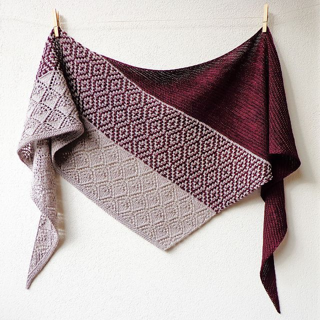 This cosy triangular shawl combines lovely graphic mosaic knitting, garter stitch and a beautiful lace pattern that echoes the diamond mosaic motif.