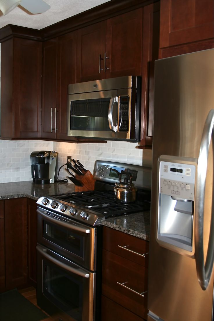 Black Stainless Kitchen Appliances Cherry Cabinets