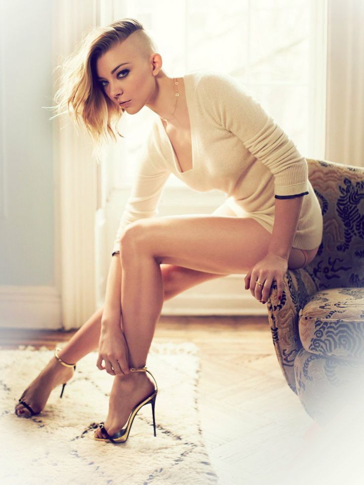 "Natalie Dormer Age: 35 Height: 5'6"" Style Form-fitting low-cut white sweater Stiletto sandals Half-shaved hair Heavy makeup"