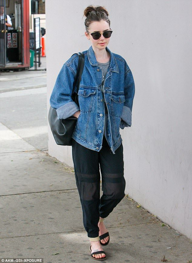 Casual chic: Lily Collins showed off an altogether more pared back look as she stepped out...