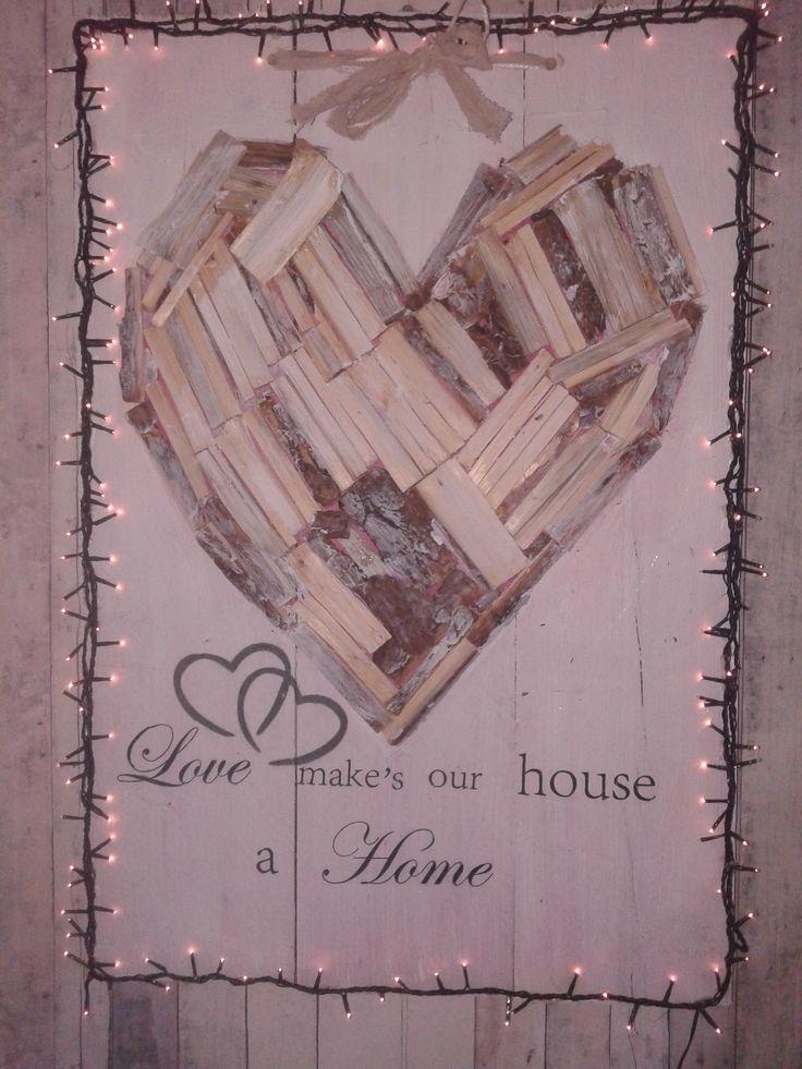 Wandbord  met tekst.  Van sloophout en openhaardhoutjes gemaakt