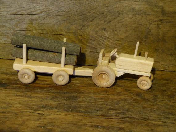 Hey, I found this really awesome Etsy listing at https://www.etsy.com/listing/177971110/wood-toy-tractor-with-log-wagon-wooden