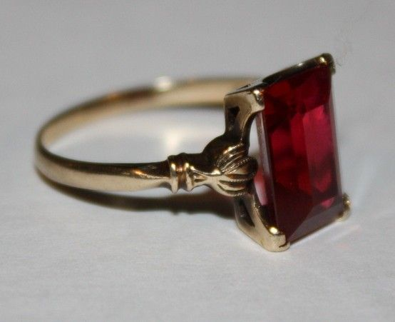 Antique ruby ring...this looks like my mom's ruby that Dad gave to her on her18th birthday  (but Mom's band is plain)
