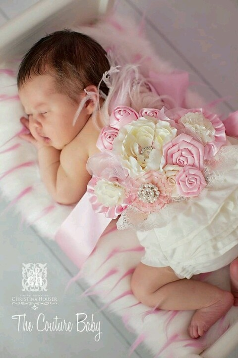 Baby with maternity sash. I love the idea of reusing it!