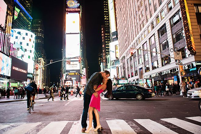 Couple kissing in Times Square | NYC Engagement | Kathleen Hertel Photography