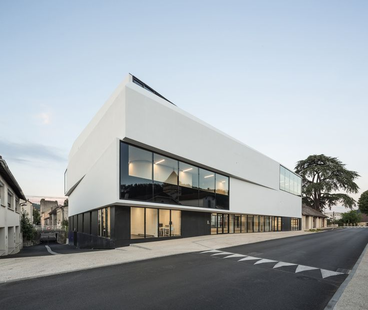 """Completed in 2017 in Cahors, France. Images by Luc Boegly. Overlooking the Valentré Bridge and the Lot River, the CHAI building is a """"beacon,"""" the new civic heart of a green and recreational zone extending..."""
