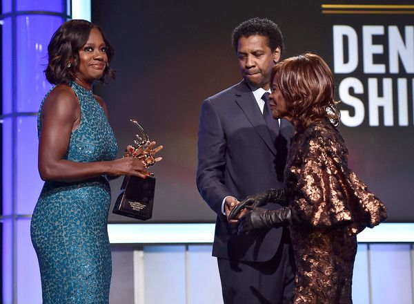Honoree Denzel Washington (C) accepts the Hollywood Legacy Award from actors Viola Davis (L) and Cicely Tyson onstage during BET Presents the American Black Film Festival Honors on February 17, 2017 in Beverly Hills, California. - BET Presents the American Black Film Festival Honors - Roaming Show