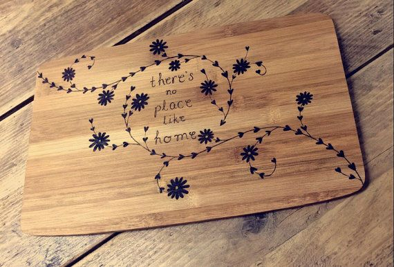 There's no place like home chopping board - personalised bamboo cheese board designed with pyrography and floral heart border pattern by RockeryCottage