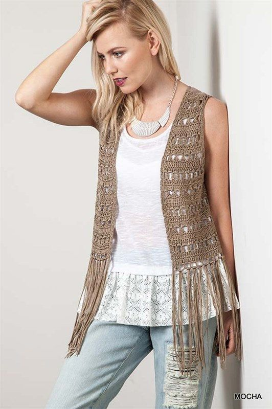 Western meets bohemian in this casual cute knit vest. The aztec inspired design on the back goes perfectly with the fringe on the bottom. This looks great with a white tee shirt and jeans for the perfect laid back look. Imported 60% Cotton 40% Polyester Model is 56 and wearing a size small