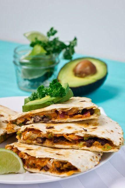 Quesadillas - flour tortillas, black beans, chipotle hummus, tomato, onion, scallion, cilantro, and avocado. CHIPOTLE HUMMUS sounds particularly intriguing!