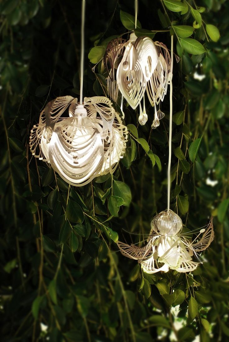 Tord Boontje Future Flora lights.  Like organic flowers that could have been plucked off a tree.  The man is a genius.