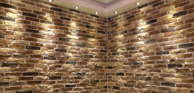 The remarkable Autumn Blend Brick Slips using off white mortar and spot lights.