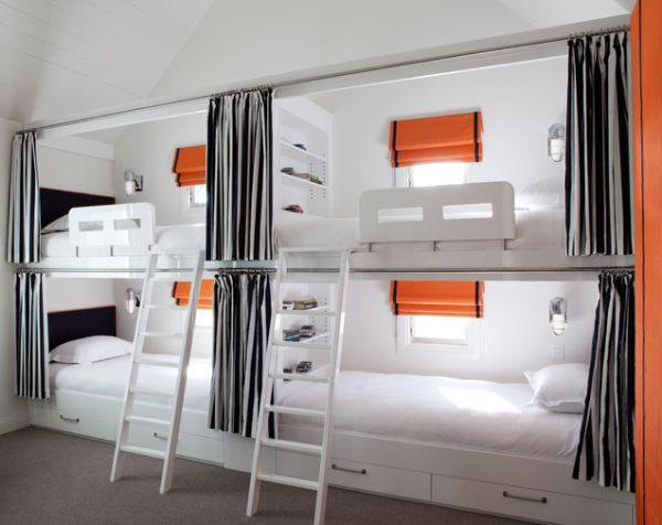 Bunk Beds For Four - this is so well designed - there is a window in each bunk so they built the house with these beds in mind. The individual lamps, shelving and curtains add some level of privacy too.